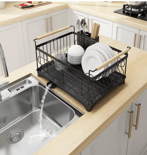 A kitchen with a sink and a window Description automatically generated